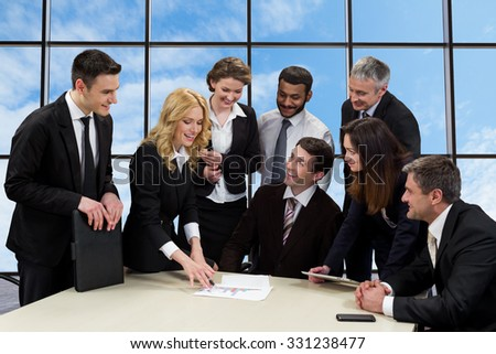 Managers are discussing of business project. International meeting of businessmen. Meeting investors. - stock photo