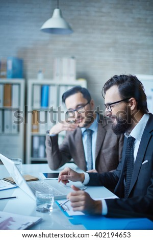 Managers at discussion - stock photo