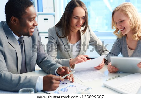 Managers being gathered to discuss business plan - stock photo