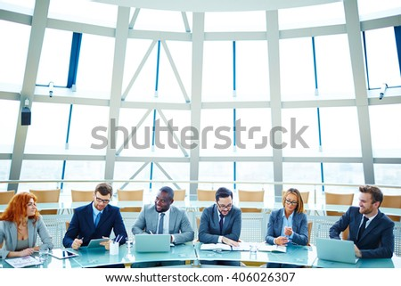 Managers sitting in conference hall and waiting for the conference - stock photo