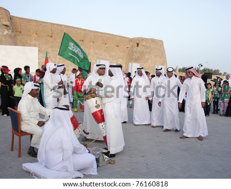 """MANAMA, BAHRAIN - APRIL 28: People performs folklore pearling songs with traditional musical instruments during annual heritage festival  """"Pearl Glitter"""" 2011 in Manama, Bahrain on April 28, 2011 - stock photo"""
