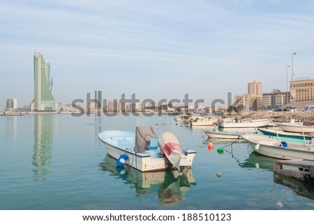 MANAMA, BAHRAIN - FEBRUARY 27, 2009: Manama cityscape with fishermen boats foreground. Bahrain offers visitors a rich history, relaxing beaches and opportunities for fishing and diving.  - stock photo