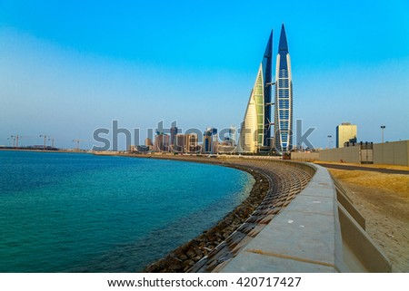 MANAMA, BAHRAIN- MAY 14: Manama Seafront with Bahrain World Trade Center and other high rise buildings in Manama City on May 14, 2016, Manama, Bahrain - stock photo