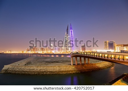 MANAMA, BAHRAIN- MAY 14: Manama Seafront with illuminated Bahrain World Trade Center and other high rise buildings in Manama City on a hazy evening on May 14, 2016, Manama, Bahrain - stock photo