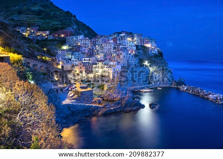 Manarola small town, from Cinque Terre, Italy, surprised by night. - stock photo