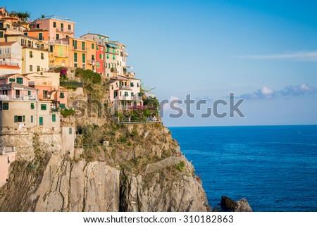 Manarola village hangs on cliff of Cinque Terre in Italy - stock photo