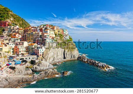 Manarola village on cliff rocks and sea at sunset., Seascape in Five lands, Cinque Terre National Park, Liguria Italy Europe.  - stock photo