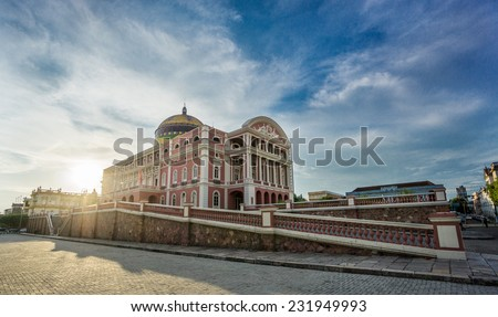 MANAUS - AUG 9: Amazonas Theatre facade at sunset day on August 9, 2014 in Manaus, Brazil. The opera house was built when fortunes were made in the rubber boom. - stock photo