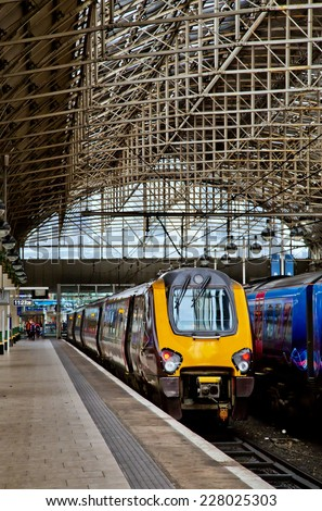 MANCHESTER,ENGLAND- OCTOBER 8,2014: A Class 220 Voyager multiple unit awaits its departure from Piccadilly Station. - stock photo