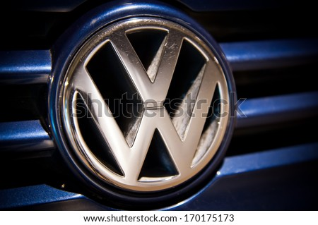 MANCHESTER - JAN 6: Close-up of VW logo on Jan. 6, 2014 in Manchester, UK. Volkswagen is a German automobile manufacturer and the biggest German automaker and the third largest automaker in the world. - stock photo