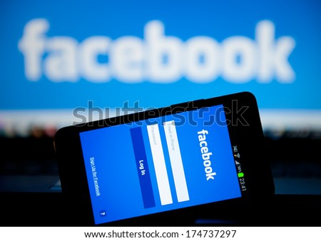 MANCHESTER - JAN 14: Facebook Sign in page on mobile phone on Jan. 14 2014 in Manchester, UK. More than 425 million active users access Facebook through mobile devices in 60 countries. - stock photo
