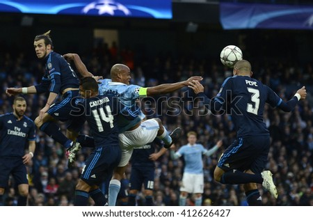 MANCHESTER, UK - APRIL 26, 2016: Gareth Bale of Real and Vincent Kompany of City pictured during UEFA Champions League semi-final game between Manchester City and Real Madrid at Etihad stadium. - stock photo
