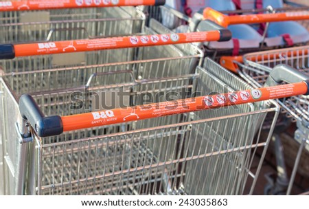 Manchester, UK - January 5th 2015: B&Q Shopping trolleys or carts with health and safety instructions. One of the largest UK DIY retailers, the health and safety of its customers is a key concern. - stock photo