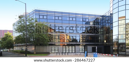 MANCHESTER, UK - JUNE 6, 2015: Office building. Manchester City Council hopes that Home will boost the economy by attracting other businesses to this part of the city centre. - stock photo