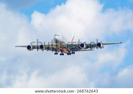 MANCHESTER, UNITED KINGDOM - APRIL 11, 2015: Airbus A380 Emirates on approach to Manchester airport on April 11, 2015. - stock photo
