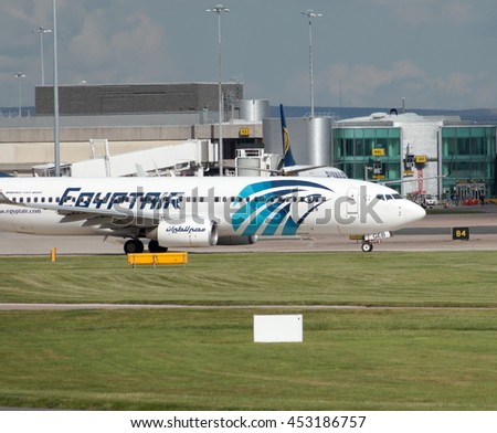 Manchester, United Kingdom - August 27, 2015: EgyptAir Boeing 737 narrow-body passenger plane (SU-GEB) taxiing on Manchester International Airport tarmac before departure. - stock photo
