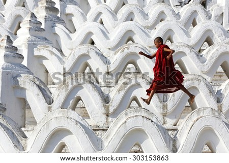 MANDALAY, MYANMAR- DEC 9 : Unidentified young Buddhism novice front temple at Hsinbyume pagoda temple on Dec 9, 2014 in Mandalay, Myanmar  - stock photo