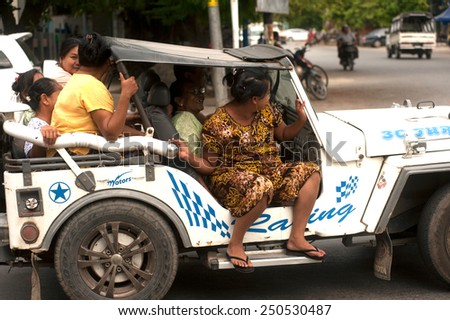 MANDALAY,MYANMAR - JULY 2 : Peoples Daily travel by car, motorcycle, in the big city.on July 2,2014 in Mandalay city,Middle of Myanmar. - stock photo