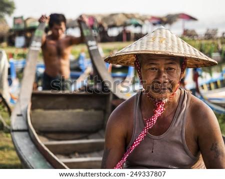 Mandalay, Myanmar - March 31, 2014: Portrait of Burmese boatman by the U Bein Bridge in Amarapura, Mandalay, Myanmar (Burma). - stock photo