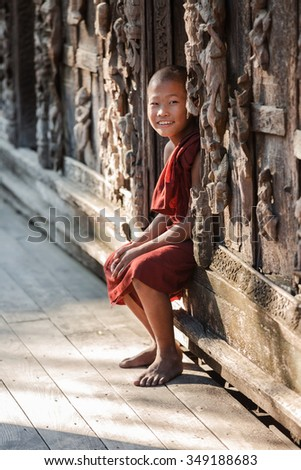 MANDALAY, MYANMAR - NOVEMBER 25 : Unidentified young Buddhism novice is relaxing after class in temple on November 25, 2015 in Mandalay,Myanmar - stock photo