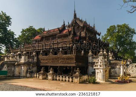 Mandalays Shwenandaw Kyaung or Shwenandaw Monastery, also known as the Teak Temple, features traditional burmese architecture - stock photo