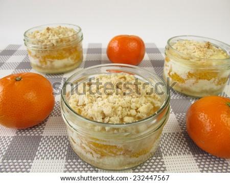 Mandarin cake in a jar  - stock photo