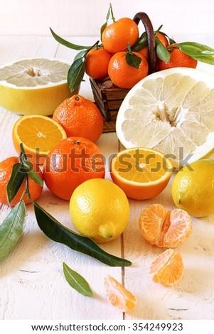 Mandarins in  basket and citrus fruits - stock photo
