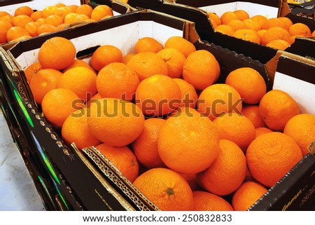Mandarins in the boxes at the food store - stock photo