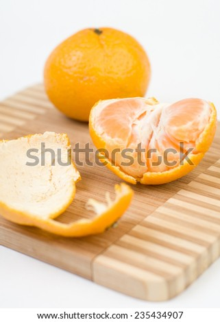 Mandarins on the kitchen cutting board closeup isolated - stock photo