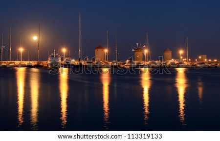 Mandraki Harbour where the colossus of Rhodes used to be located - stock photo