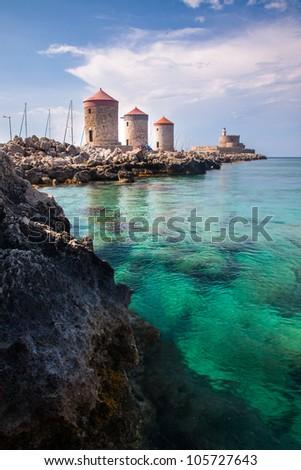 Mandraki Harbour windmills on the Island of Rhodes Greece - stock photo