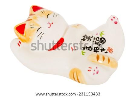 Maneki-neko - Japanese beckoning cat isolated on a white background. Traditional good luck charm. - stock photo