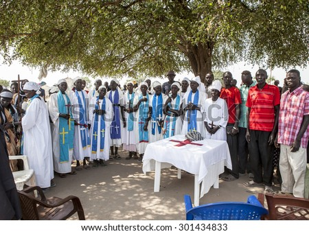 MANGALLA, SOUTH SUDAN-DECEMBER 5, 2010: Unidentified congregants have church under a tree in South Sudan - stock photo