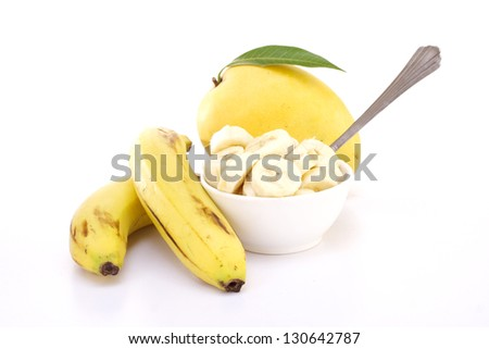 Mango and bananas on white - stock photo