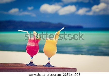 mango and watermelon cocktails on tropical beach - stock photo