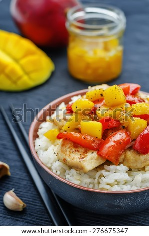 mango chicken stir fry with rice. the toning. selective focus - stock photo