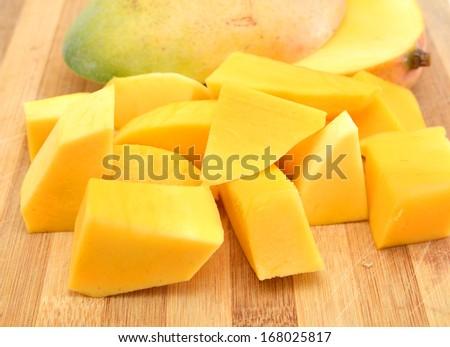 mango chunks on wooden board  - stock photo