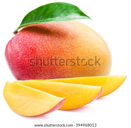 Mango fruit and mango slices. Isolated on a white background. - stock photo
