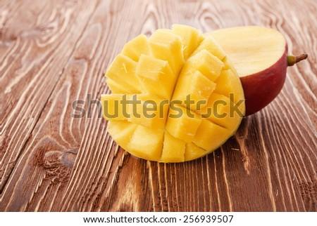 Mango fruit on wood - stock photo