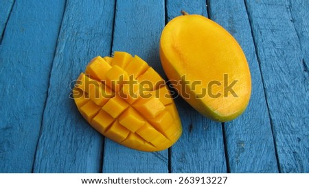 mango on wood - stock photo