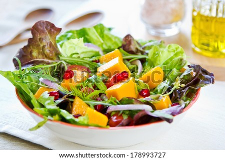 Mango with Pomegranate ,lettuce and rocket salad - stock photo