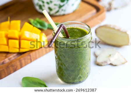 Mango with Spinach and Ginger smoothie by fresh ingredients - stock photo