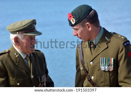MANGONUI, NEW ZEALAND - APRIL 25 2014:New Zealand Army veteran soldiers talks after the National War Memorial service. - stock photo