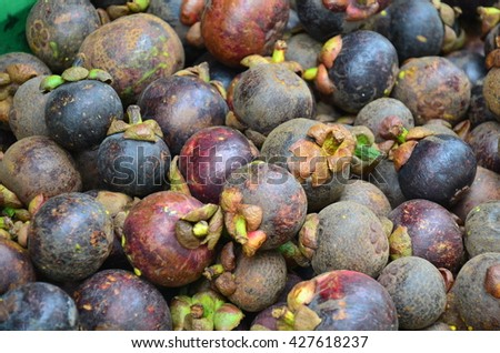 Mangosteen fruits at Fruit Shop or greengrocery on street for sale at market in Luang Prabang, Laos - stock photo