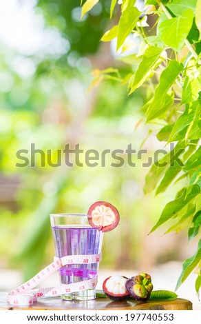 mangosteen  healthy fruit and tape measure placed on the table in the morning. - stock photo
