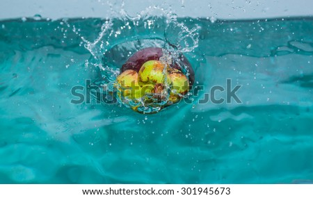 Mangosteen in the water effect. - stock photo