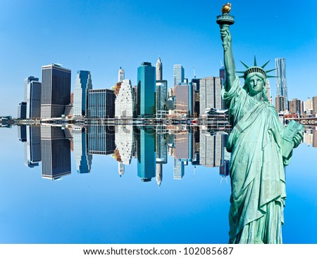 Manhattan and the statue of Liberty with reflection, New York City. USA. - stock photo