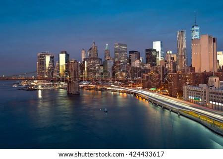 Manhattan at night in New York City. - stock photo