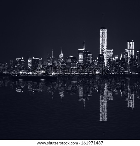 Manhattan at night, New York City skyline with reflection in Hudson River. Panorama. Black and white - stock photo