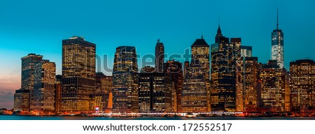 Manhattan at night with lights and reflections. New York City skyline - stock photo
